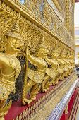 BANGKOK, THAILAND, DECEMBER 26, 2013: The Royal Palace complex - statues