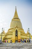 BANGKOK, THAILAND, DECEMBER 26, 2013: Tourists visit Golden Stupa at Wat Phra Kaew