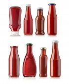 pic of bottles  - the various barbecue sauces in glass bottles on white background - JPG