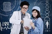 Doctor With Tablet And Futuristic Interface Background