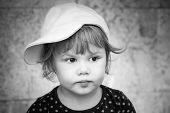Black And White Closeup Portrait Of Baby Girl Cap