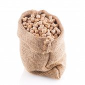 image of chickpea  - Uncooked chickpeas Uncooked chickpeas on burlap bag on white background - JPG