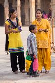 Delhi, India - November 4: Unidentified Women With Unidentified Boy Stand In Quwwat-ul-islam Mosque