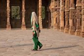 Delhi, India - November 4: Unidentified Woman Walks In Quwwat-ul-islam Mosque Courtyard At Qutub Min