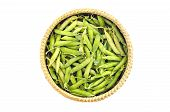Fresh Sweet Vegetable Pea Pods In Wicker Basket Isolated