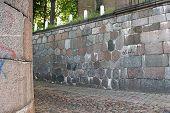 Alley Between A Brick Wall