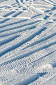 stock photo of snowy-road  - snowy winter road with tire markings and blue sky - JPG