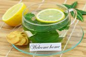Welcome home card with cup of mint tea with lemon
