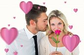 Handsome man kissing girlfriend on cheek holding a rose against hearts