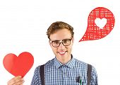 Geeky hipster holding a heart card against heart in speech bubble