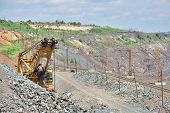 stock photo of iron ore  - View to the iron ore opencast mining site - JPG