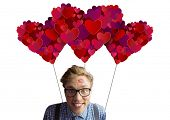 Geeky hipster covered in kisses against valentines day