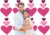 Attractive young couple hugging and smiling at camera against valentines day pattern