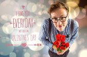 Geeky hipster holding a bunch of roses against light glowing dots design pattern