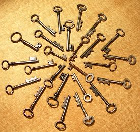 picture of skeleton key  - Old Skeleton keys in circular pattern used for locks and watchman clocks - JPG