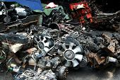 stock photo of junk-yard  - Used and surplus car engines and other car parts sold at a scrapyard - JPG