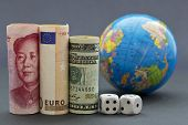 foto of yuan  - Yuan euro and collar next to black and white dice with globe in background - JPG