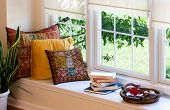 picture of guest-house  - Cup of Coffee on a Tray Piled Books and Square Pillows at the Reading Corner Inside the House - JPG