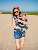 pic of little sister  - Portrait of happy teen sister and little baby brother on the beach - JPG