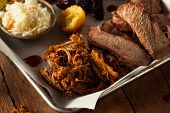 stock photo of pulling  - Homemade Barbecue Pulled Pork on a Platter - JPG