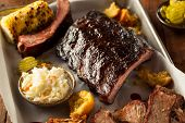 foto of ribs  - Barbecue Smoked Brisket and Ribs Platter with Pulled Pork and Sides - JPG