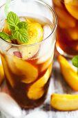 foto of iced-tea  - Glass Of Peach Ice Tea Close Up - JPG