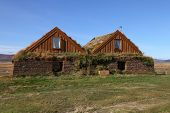 foto of iceland farm  - Exterior of Old Farm Buildings with Grass Growing on Roof Tops at Moorudalur Highlands Settlement Eastern Iceland - JPG