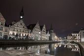 picture of gents  - The historical buildings of Gent in Belgium at night with reflections in the river Scheldt - JPG