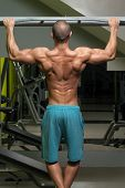 foto of pull up  - Young Male Athlete Doing Pull Ups - Chin-Ups In The Gym ** Note: Soft Focus at 100%, best at smaller sizes - JPG