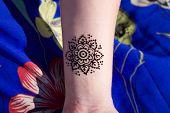 pic of mehendi  - black henna tattoo mehendy on hand mandala - JPG