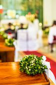 stock photo of pews  - Church pews decorated with bouquets during the wedding ceremony - JPG