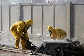picture of decontamination  - Man in chemical protection suit carrying out the decontamination area - JPG