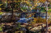 foto of guadalupe  - A Beautiful Waterfall and Beautiful Fall Foliage On The Guadalupe River - JPG