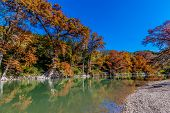pic of guadalupe  - Bright Fall Foliage Surrounding the Guadalupe River at Guadalupe State Park - JPG