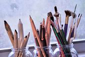 pic of bristle brush  - Paintingdrawing and sketching tools. Graphite and charcoal pencils for fine art in the middle and blending stumps or tortillons for blending pencil drawings to the left. Bouquet of colorful brushes of different types and sizes to the right. ** Note: Shal - JPG