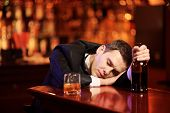 Young Drunk Man Sleeping In The Bar