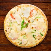 image of hot fresh pizza  - Delicious pizza with chicken parmesan tomatoes white sause and fresh arugula  - JPG