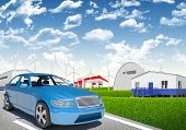 foto of wind wheel  - Blue car with wind generator and petrol station on urban background - JPG