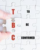 picture of confirmation  - Hand of a business man completing the puzzle with the last missing piece - JPG