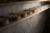 pic of basement  - Goat cheese maturing in basement. Studio shoot with mystic light efect. ** Note: Shallow depth of field - JPG