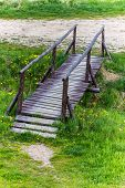 pic of old bridge  - Small old wooden bridge over the stream - JPG