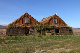 pic of iceland farm  - Exterior of Old Farm Buildings with Grass Growing on Roof Tops at Moorudalur Highlands Settlement Eastern Iceland - JPG