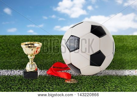 sport, achievement, championship, competition and success concept - close up of football or soccer b