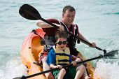 image of watersports  - Father and son kayaking - JPG