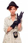 Red Haired Female Detective Putting on Gloves Wearing a Badge, Trench Coat and Hat Isolated on a Whi