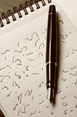 foto of stenography  - Classic fountain pen resting on pad with shorthand - JPG