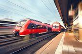 Modern High Speed Red Passenger Trains At Sunset. Railway Station poster