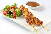 Chicken kebabs and salad.  Skewed satay chicken, with satay sauce.