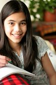 stock photo of teenage girl  - young teenage girl writing in notebook studying