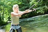 stock photo of fisherwomen  - woman fishing in river in summer country - JPG